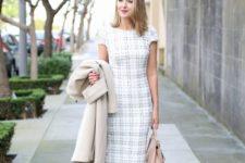 ivory plaid sheath dress with shirt sleeves, cream shoes, a neutral bag and a crema coat