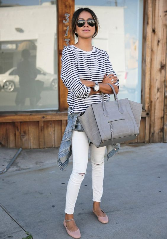 white ripped skinnies, a striped top, a denim jacket, blush flats and a grey bag