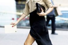 With beige button down shirt, midi skirt and clutch