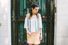 With beige mini skirt and lace up sandals