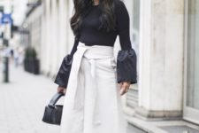 With black blouse, black lace up sandals and mini bag