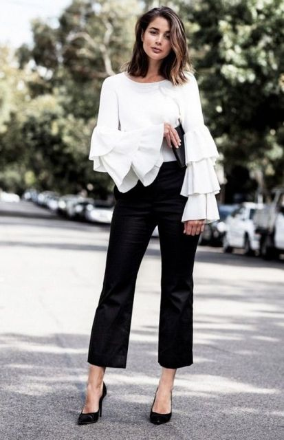 With black crop pants, black pumps and black clutch