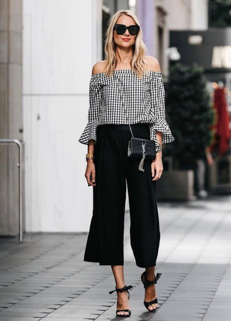 With black culottes, crossbody bag and black high heels
