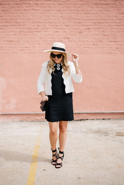 With black dress, black and white wide brim hat and lace up sandals