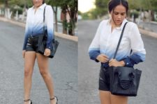 With black leather shorts, black shoes and bag