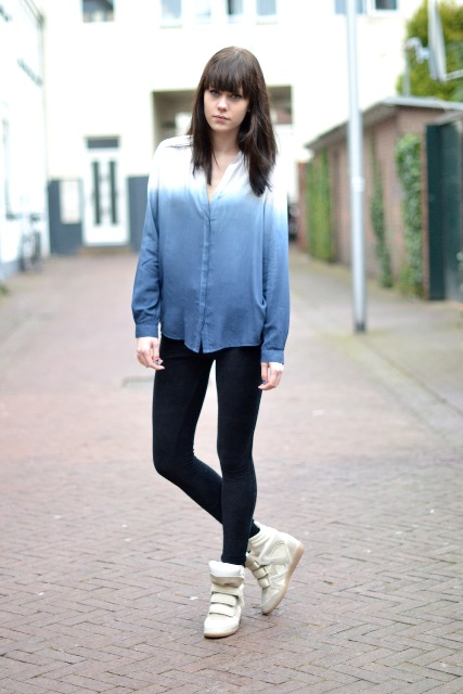 With black leggings and white sneakers