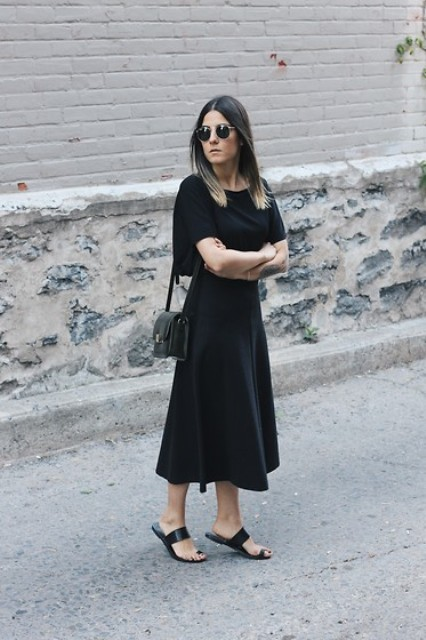 With black midi dress and black small bag