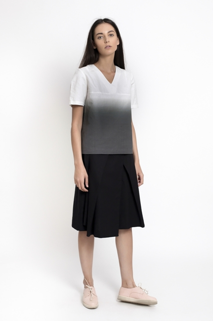 With black midi skirt and pale pink shoes