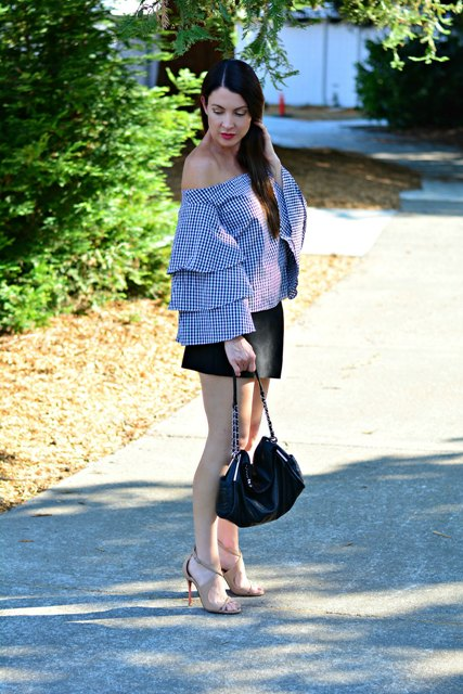 With black mini skirt, beige sandals and black bag