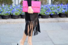 With black shirt, gray pumps and hot pink clutch