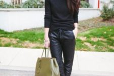With black shirt, white pumps and olive green bag