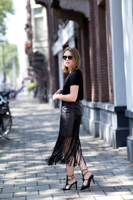 With black t shirt and high heels