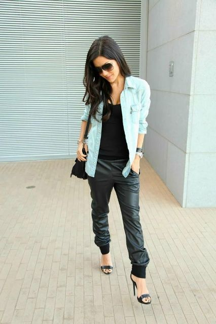 With black top, high heels, light blue jacket and bag
