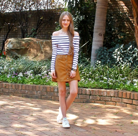 With brown mini skirt and white sneakers