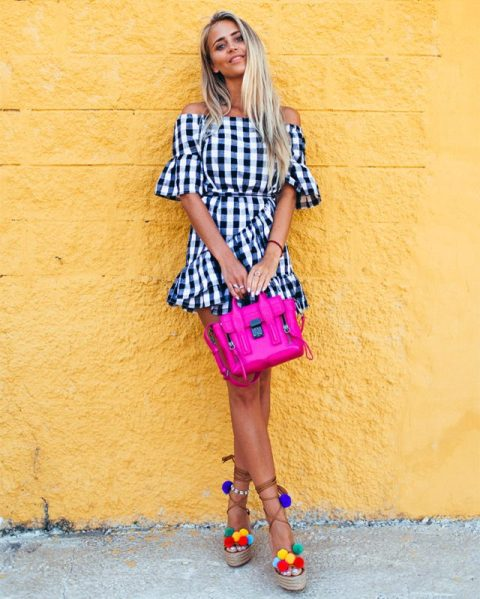 With checked dress and pink bag