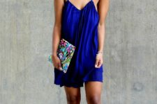 With cobalt blue mini dress and printed clutch