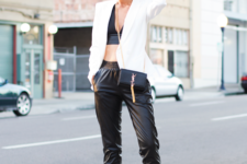 With crop top, black pumps, white blazer and mini bag