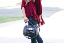 With cuffed jeans, leather bag and ankle boots