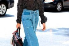 With denim culottes, two colored bag and black mules