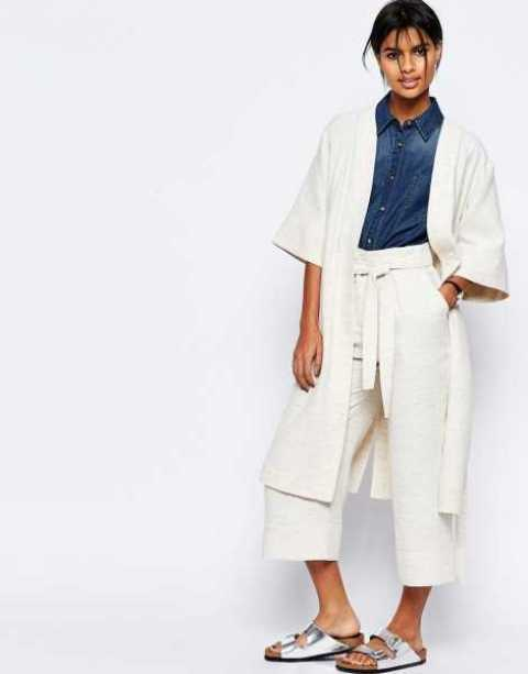 With denim shirt, white long blazer and silver flat sandals