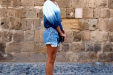 With denim shorts, clutch and two colored flats