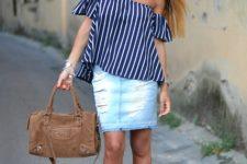 With denim skirt, fringe heels and brown bag