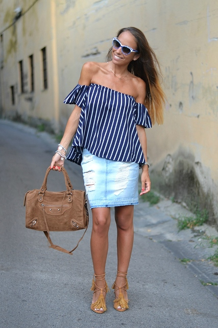With denim skirt, fringe heels and brown bag