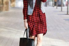 With denim vest, black hat, black leather tote and ankle boots