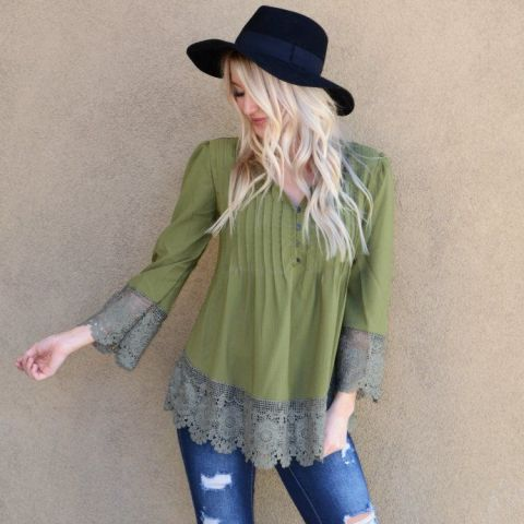 With distressed jeans and black hat