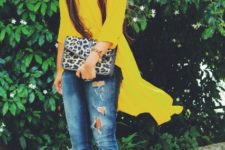 With distressed jeans, black pumps and leopard clutch