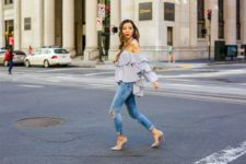 With distressed skinny jeans and beige pumps