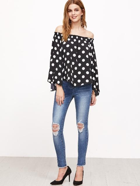 With distressed skinny jeans and black pumps