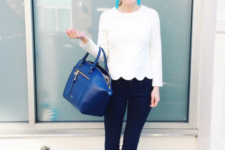 With flare trousers and blue bag