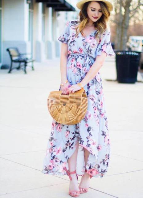 With floral maxi dress, pink heels and hat