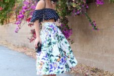 With floral midi skirt, lilac pumps and chain strap bag