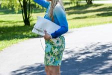 With floral skirt, white pumps and white clutch
