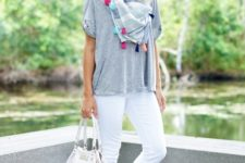With gray loose t-shirt, printed scarf, white pants and white bag