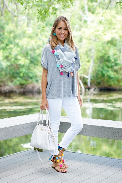With gray loose t shirt, printed scarf, white pants and white bag