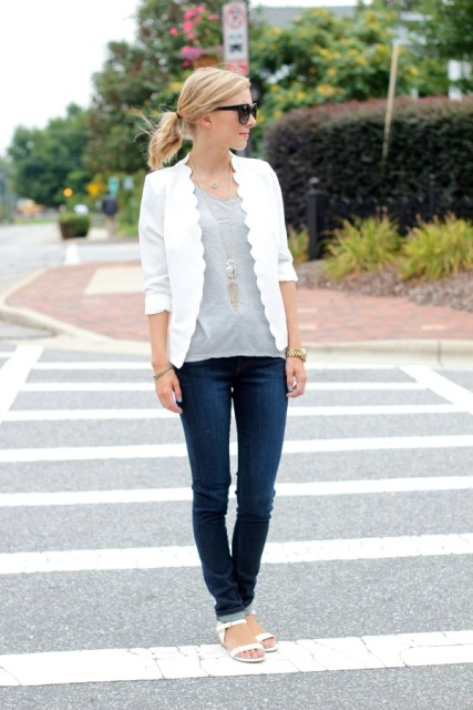 With gray shirt, jeans and white flat sandals