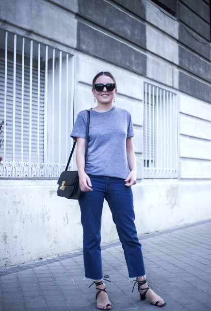 With gray t shirt, crop jeans and black bag