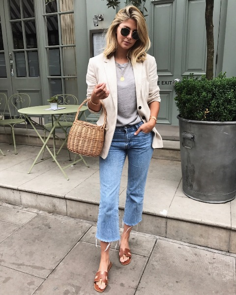 With gray t shirt, crop jeans, brown sandals and beige jacket