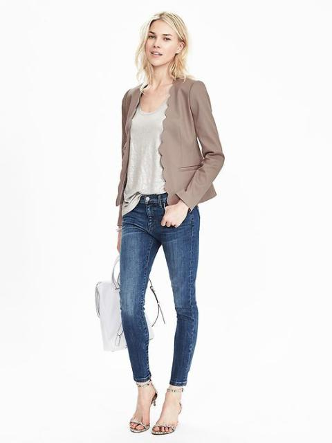 With gray top, skinny jeans, high heels and white bag