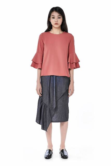 With gray wrap midi skirt and flat shoes