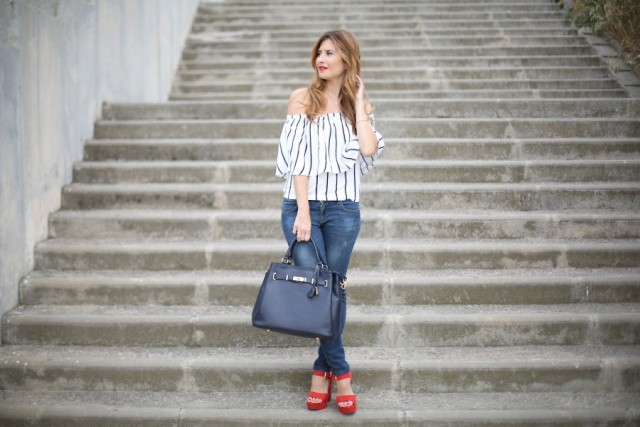 With jeans, black bag and red platform shoes