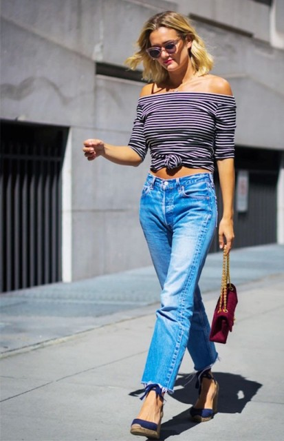 With jeans, blue shoes and marsala bag
