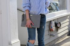 With jeans, gray cutout boots and gray clutch