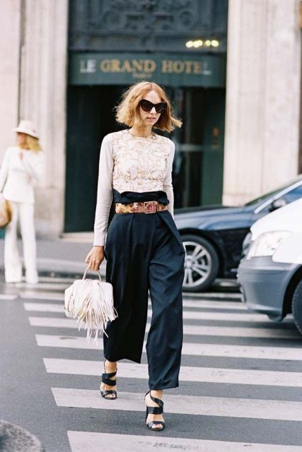 With lace blouse, black heeled sandals and white fringe bag