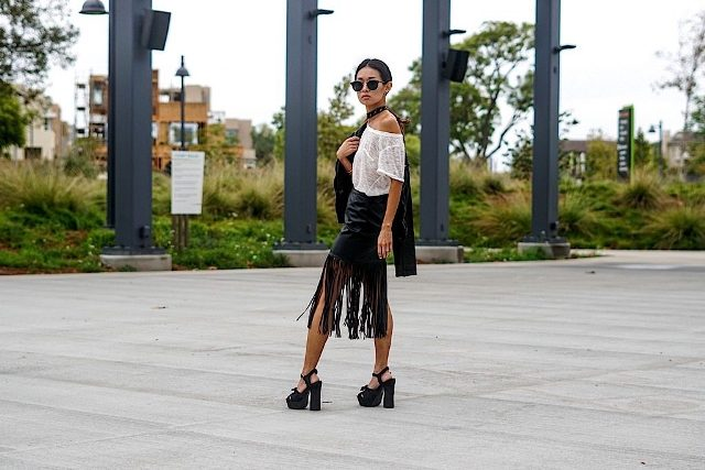 With lace shirt, platform sandals and black jacket