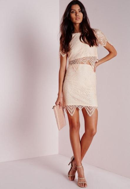 With lace skirt, sandals and beige clutch