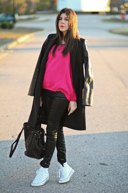 With leather pants, sneakers, coat and bag